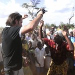 Jose Antonio Ruiz Diez dancing with locals in DRC following construction of his school
