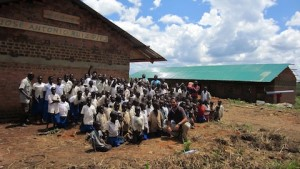 The student group posing in front of their new school!