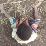 Child sitting on the ground
